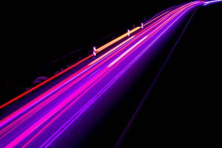 violet car lights at night. long exposure Imagens