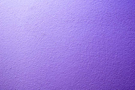 the wall is painted with purple paint with visible details