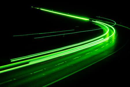 green car lights at night. long exposure Banque d'images