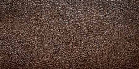 brown faux leather with visible details. background