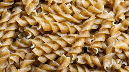 wholemeal pasta with visible details. background or textura