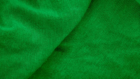 green cotton fabric with visible details. background