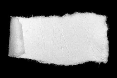 a white piece of paper on a black isolated background Reklamní fotografie