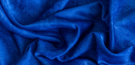 rinkled blue cotton fabric with visible texture Standard-Bild