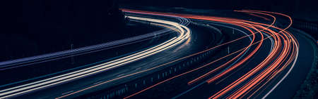 lights of moving cars at night. long exposure