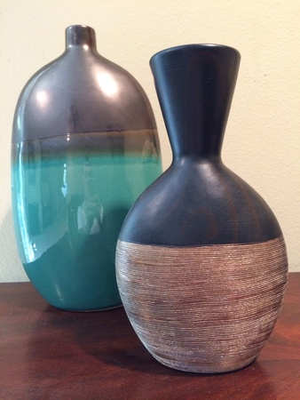 Two vases on table
