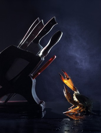 Black background in the fight against knife and crabs photo