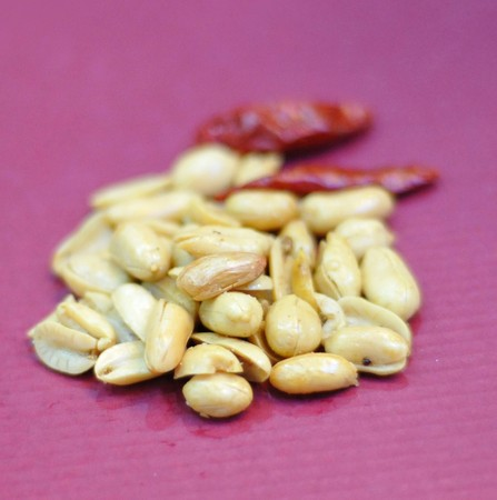 goober: A pile of peanuts in the red background Stock Photo