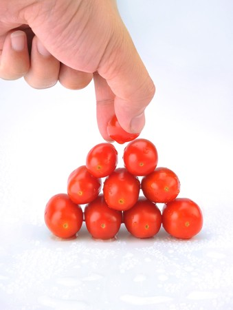 selected: Small tomatoes in a white background