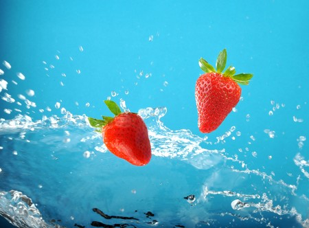 Fresh colored splash with strawberry Stock Photo - 4339597