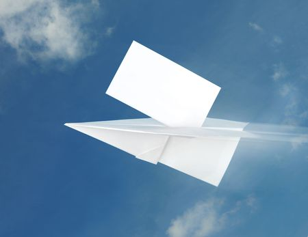Paper airplane in the blue sky background