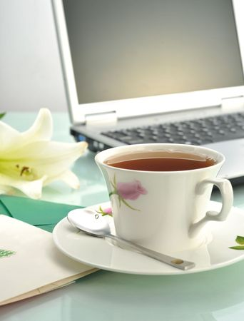 Cup of coffee and Greeting cards on laptop Stock Photo