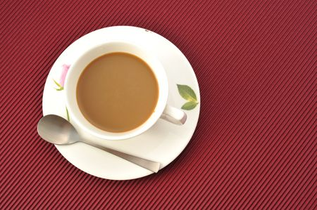 Coffee cup over red  background Stock Photo - 4726083
