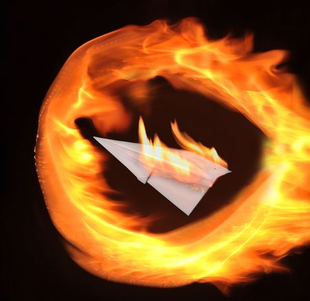 Paper airplane and combustion fire photo