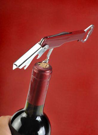 sociability: Opening a wine bottle with corkscrew,