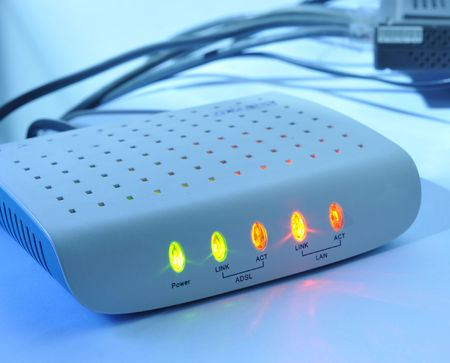 Networking and security concepts.  ADSL router on a white background. Stock Photo - 4731070