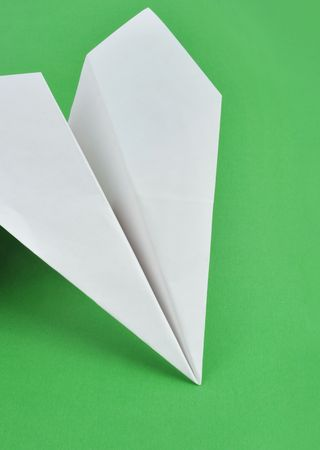 Paper airplane in the green background