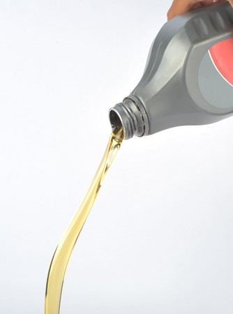 motor transport: machine oil flows out on white background Stock Photo