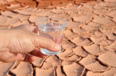 thirst: hand holding a glass of water Stock Photo