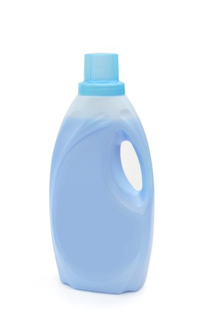 Bottle of blue cleaning detergent on a white background photo