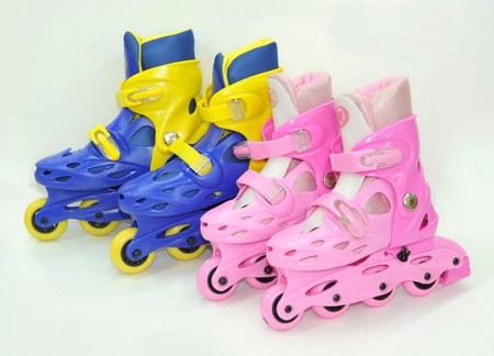 Two pairs of hockey skates
