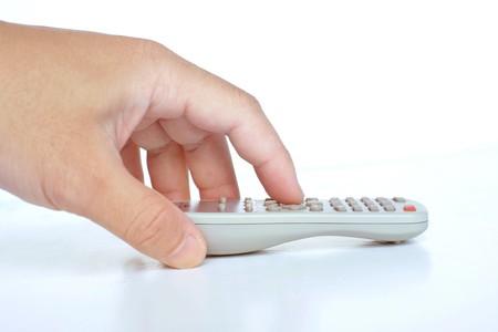 Hand press the tv remote