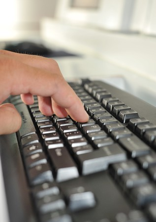 Hand on keyboard Stock Photo