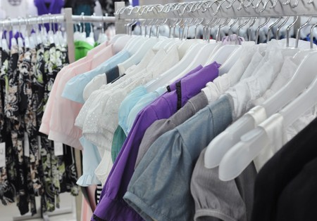 Close-ups of the clothes on the racks