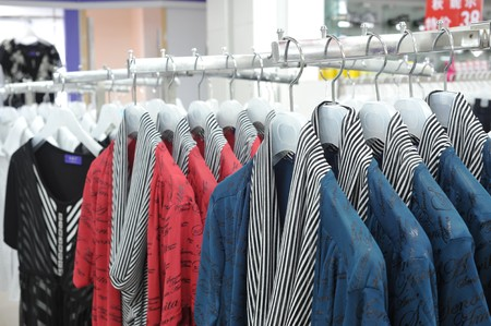 On clothing store clothes rack clothes