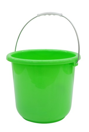 Empty Green bucket on a bright Background