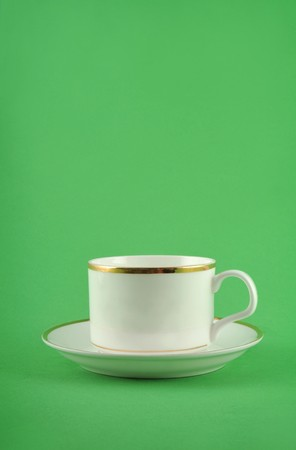 Coffee cup isolated in green background