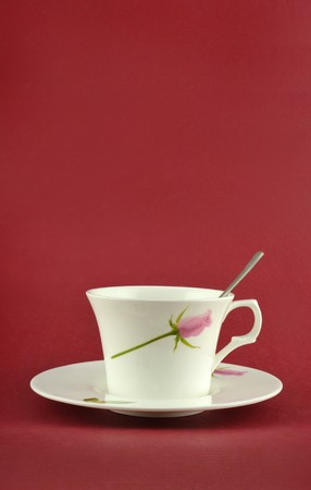 Coffee cup isolated in red background