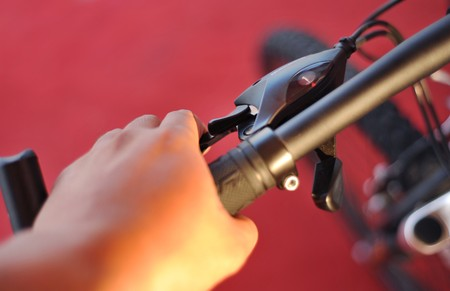 handlebar: Hand holding bicycle handlebar