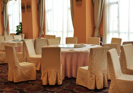 round chairs: Interior of chinese restaurant with round tables and chairs.