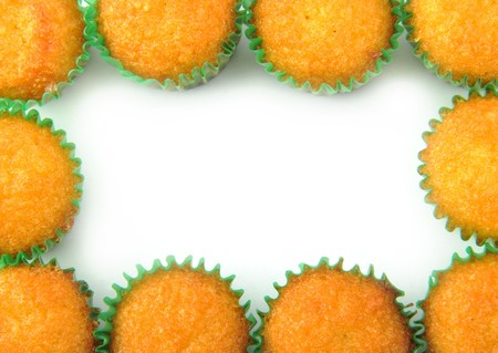 cakes and pastries: Frame made of cup cupcake isolated on white