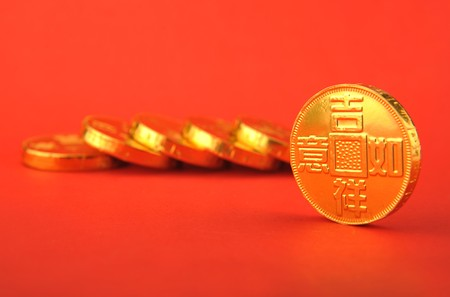 finanical: Gold coins on a red background