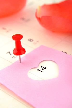 loveheart: Close-up on February 14 calendar and petals