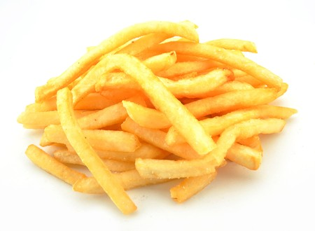 A pile of French Fries isolated on a white background.