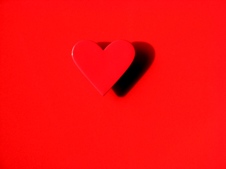 Red Heart on the Red Background