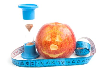 centimetre: Red apple with centimetre and a sand-glass on a white background