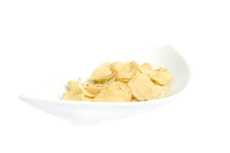 Chips on a white plate on a white background photo