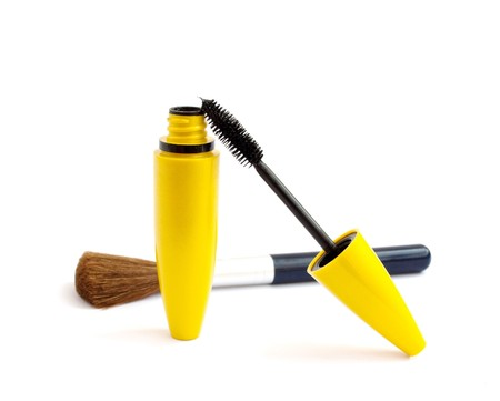 black mascara and a brush for makeup on white background photo