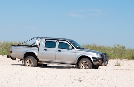 gray car in the sand photo