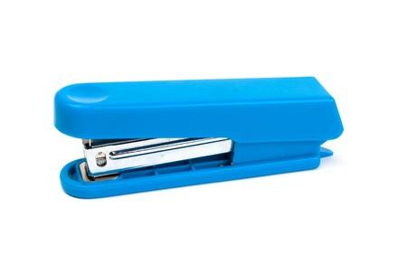 Dark blue stapler on a white background photo