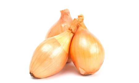 pealing: onion on a white background