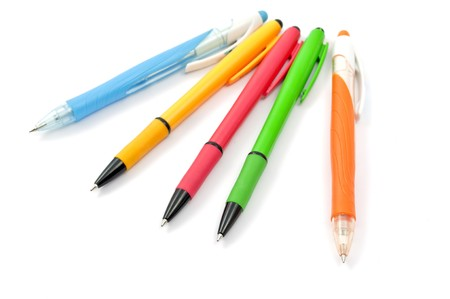colored pens on a white background photo