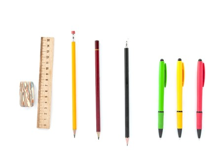 colored pens, pencils, ruler, eraser on a white background photo