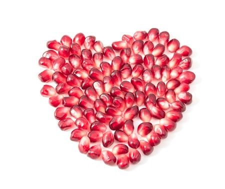 Valentines heart shape made by pomegranate seeds photo