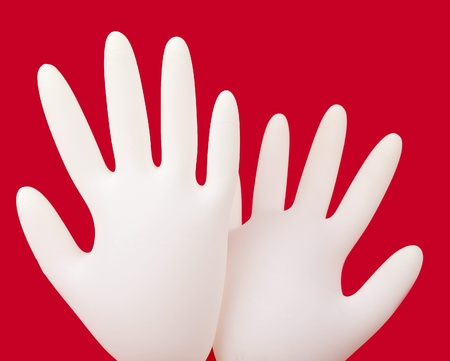 medical gloves on red background photo