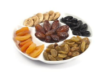 Different kinds of dried fruits on white background photo
